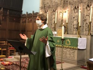 Adam Trambley at St. John's Episcopal Church preaching with mask August 2020