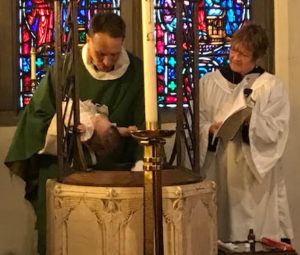 Baptism at font at St. John's